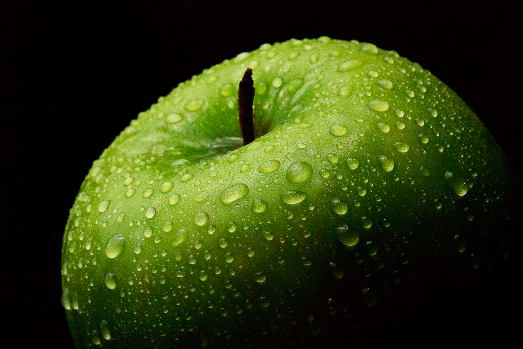 "Still Life photograph of a water covered apple entitled ""An Apple a Day"", taken by Rhode Island photographer Mike Dooley"