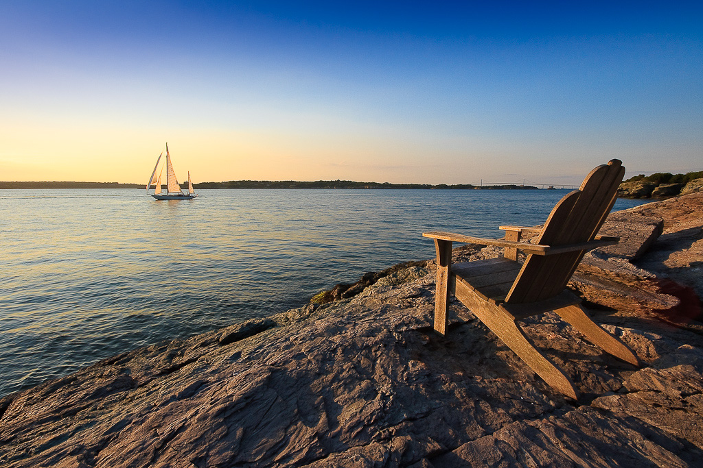 Photograph of a sailboat on Narragansett Bay along the coast of Newport, Rhode Island. Taken by Rhode Island photographer Mike Dooley