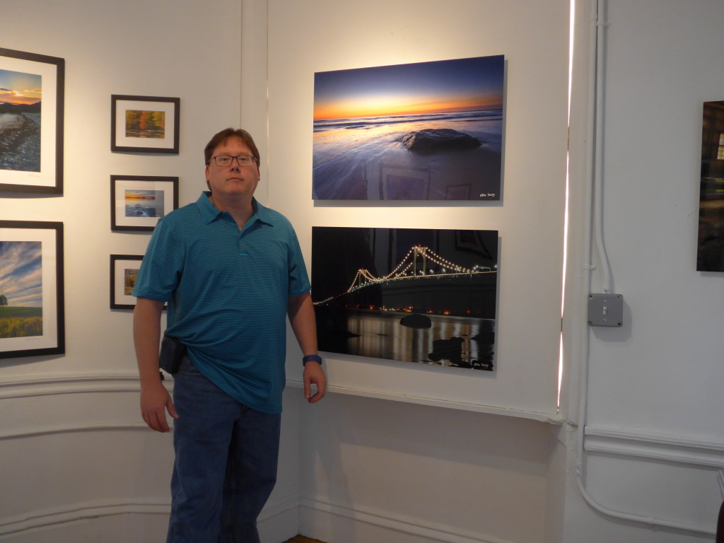 "Photographer Mike Dooley stands with 2 of his  20""x30"" aluminum prints at Peter Miller Fine Art Gallery"